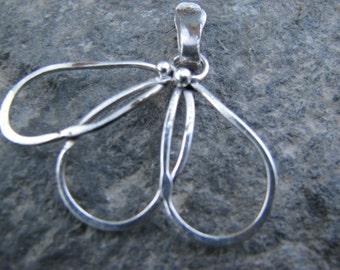 delicate silver wire pendant