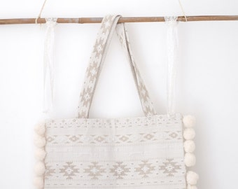 Ethnic bag with PomPoms