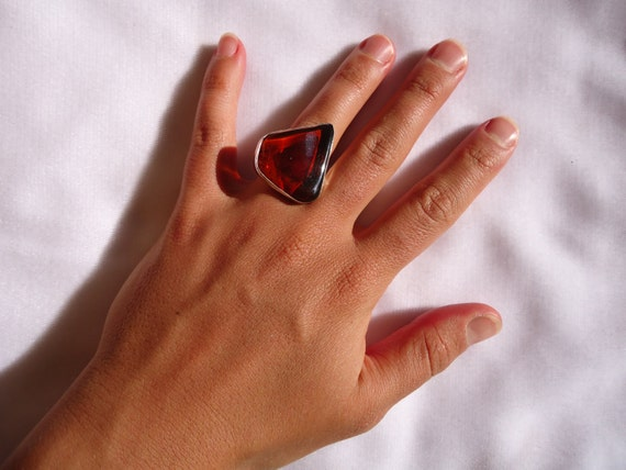 Beautiful free form redish Mexican amber silver ring
