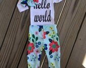 Baby girl hello world 3 pieces sprint flower outfit. All sizes please inquire.