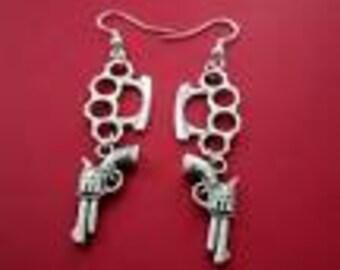Brass knuckle and pistol earrings