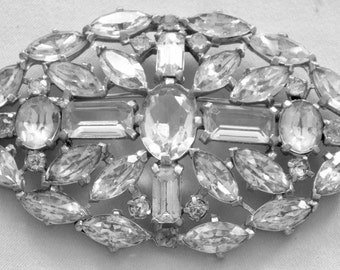 Antique Brooch crystal stones weighs 57 grams.
