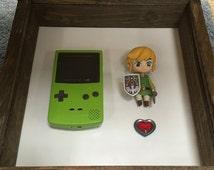 Handmade vintage looking frame - Green Nintendo GameBoy shell with Zelda (Link) figure.
