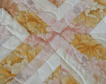 Traditional feminine pink and golden toned quilt
