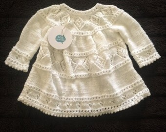 Hand knitted, white baby dress
