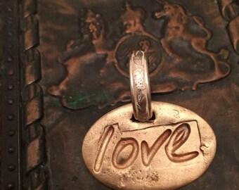 Love charm in bronze