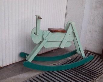 Old toy wooden cricket rocker