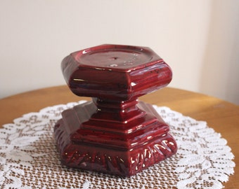An eye catching hexagon shaped burgandy candleholder