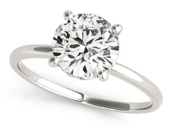 Solitaire Style Moissanite And Diamond Engagement Ring 0.90 Ctw.