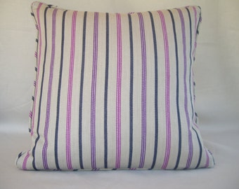Striped cushion cover in plum, charcoal grey and sharp pink colours.