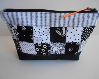 Scrappy Zippered Pouch. Black and white patchwork cosmetic bag to hold make up and other little items.