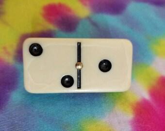 A domino pin