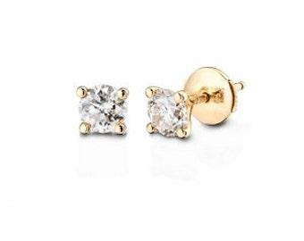 Earrings / rings 14K gold... 1.4 gr diamond Center: 1.10 CT