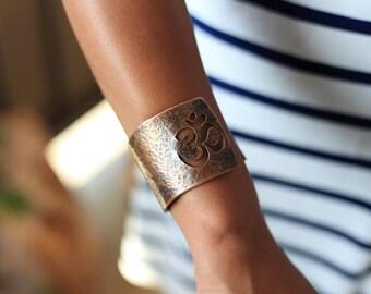 Handmade copper bracelet cuff with a OM sign cut