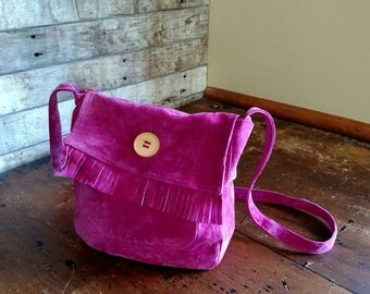 Hot pink suede leather handbag.
