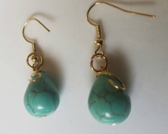Handmade wire wrapped turquoise bead dangle earrings.