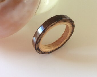 Wooden ring by Tineohout combined with beech wood
