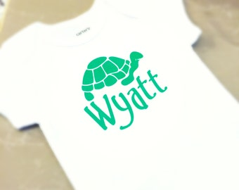 Onesie with turtle and name in neon pink or green