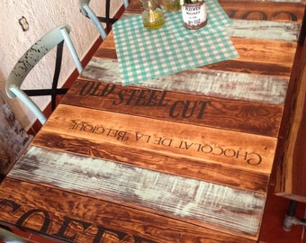 AQUA and burned wood kitchen table with words