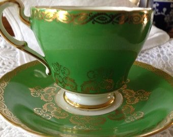 Vintage Paragon Green with gold gilt lacing  tea cup and saucer
