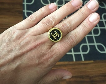 Black and gold Chanel button ring