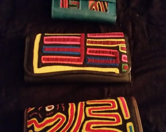 Leather Wallets and stiched fabric