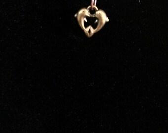 dolphin heart on a hemp necklace