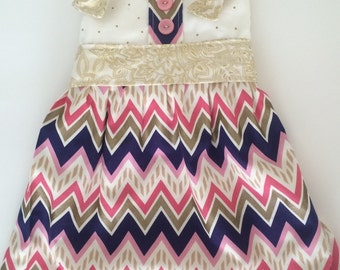 Pink, navy, and gold knot dress