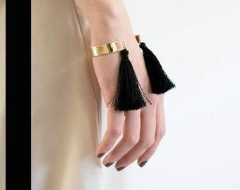 Golden bangle cuff with tassels (fringes) black
