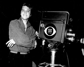 "Elvis Presley at 21-Years Old Next to a CBS-TV Camera on the Set of ""Stage Show"" - 5X7, 8X10 or 11X14 Publicity Photo (EP-272)"