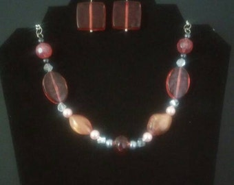 Pink necklace, bracelet, earrings and ring set