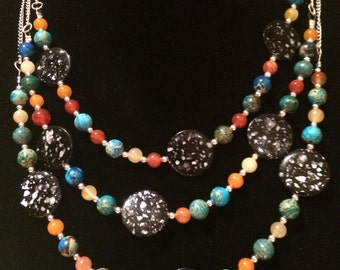 Handmade three strand multi-bead necklace .