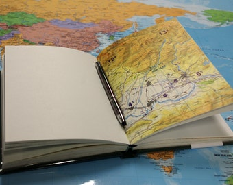 Travel books with maps from various countries throughout