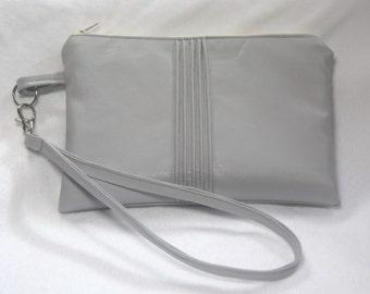 Wrist bag super soft leatherette with tucks