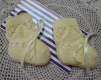 Hand knitted baby bootees in lemon yellow