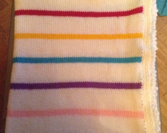 White cover with coloured stripes