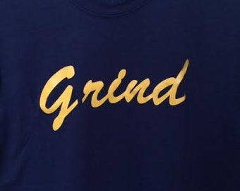 Grind t shirt in gold cad cut vinyl