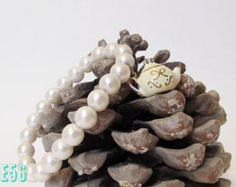 teapot and pearl bracelet - restored