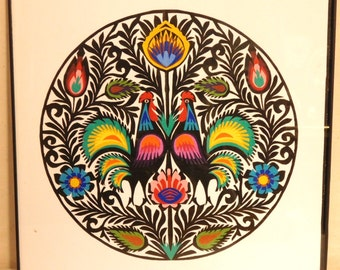 Polish folk art paper cutting with multicolor roosters