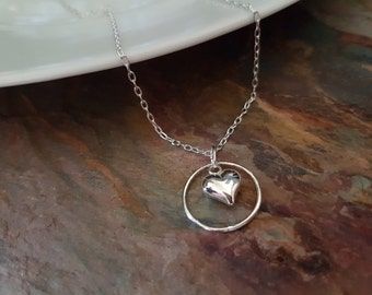 Sterling Silver, circle and puffed heart necklace