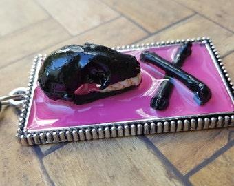 Bat skull and crossbones necklace