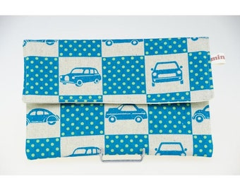 Cover cover cotton sand and turquoise tiles with drawings of cars, cotton lined.