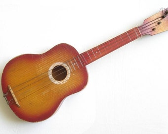 Vintage USSR Soviet Russia wooden child's guitar toy with 4 strings
