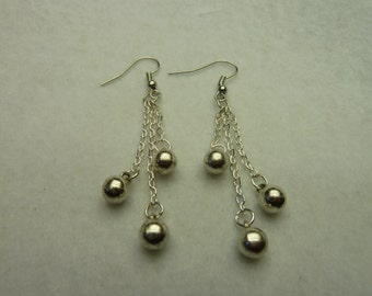Silver earrings with chains look