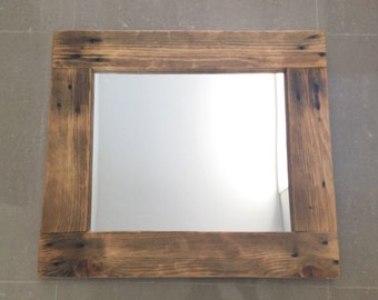 Mirror framed by Pallet Timber
