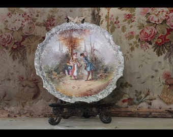 Antique hand-painted porcelain plate.
