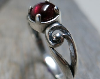 Spirit of Imbolc ring ... cast sterling silver / spiral scrolls / garnet / US ring size 8