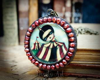 The discovery, an original mixed media metal and glass pendant and necklace inspired by an original circus girl surreal painting by Danita