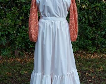 Ladies, size 12/14 Pioneer/Prairie costume in orange floral print with cream pinafore.