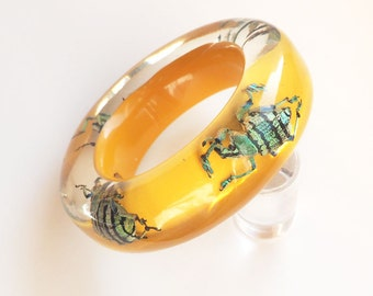 Yellow bagel lucite bracelet with real iridescent insects